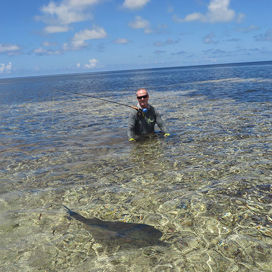 A GT release by a saltwater fly fisherman on Providence Atoll