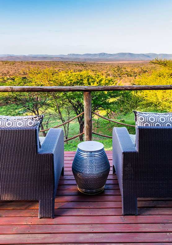 two armchairs on the deck looking out with a view over the bushveld plains at Little Bayete Zulu South Africa