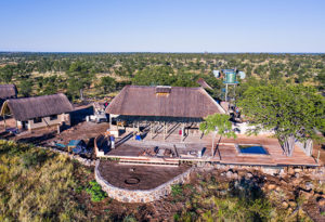 an aerial view of the main lodge and boma area at Deka Camp in Hwange National Park, Zimbabwe