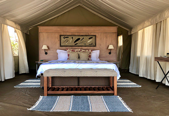 a view from the luxury tent entrance toward the double bed at Ingwe Pan Camp, Mana Pools Zimbabwe