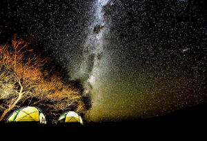 the night sky shines with tents lit up by lanterns when out camping in fly camps at Northern Patagonia Lodge, Argentina