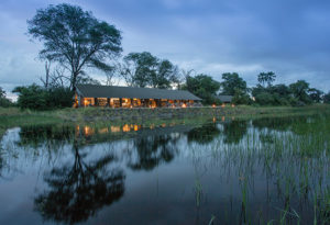 a view over the marshland toward the main lodge building at Gomoti Plains camp in the Okavango delta, Botswana
